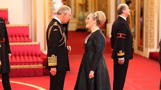 Adele at palace for MBE honour