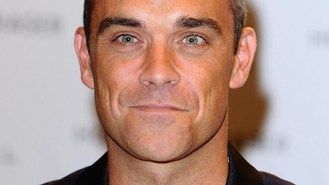 Robbie Williams entertains fan