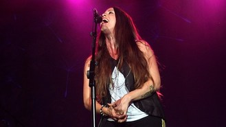 Alanis feeling new love as a woman