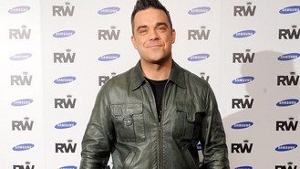 Robbie's song makes daughter sick