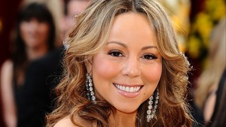 Mariah Carey sings Triumphant tune