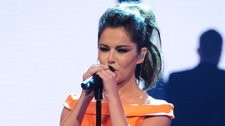 Cheryl shows off new back tattoo