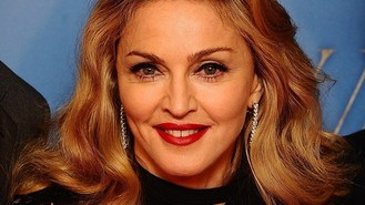Madonna booed after touting Obama