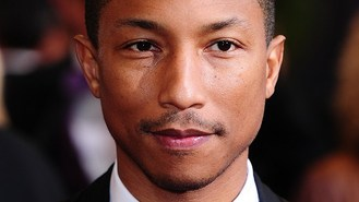 Pharrell 'happy' at chart success