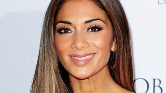 Scherzinger makes 'magic' in studio
