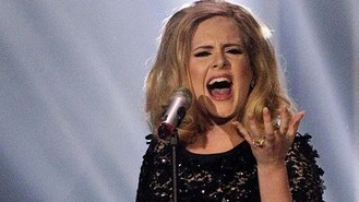 Adele 'needed convincing' over Bond