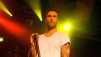 Levine sorry about postponing shows