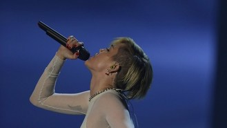 Miley Cyrus sparks up on stage