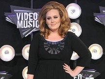 Adele to undergo throat operation