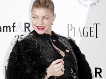 Fergie helped onstage to get award