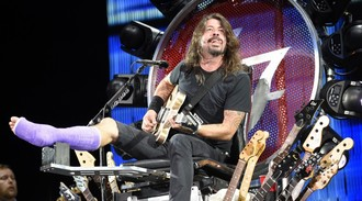 Foo Fighters' Dave Grohl makes stage comeback on throne