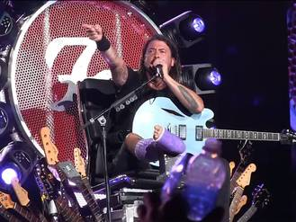 Dave Grohl brings his doctor on stage to sing 'Seven Nation Army' during Foo Fighters gig