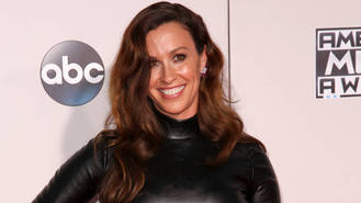 Alanis Morissette shows off her pregnancy in all its glory in naked pool shot