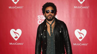 Rock legend Lenny Kravitz takes in new furry friend on charity tour
