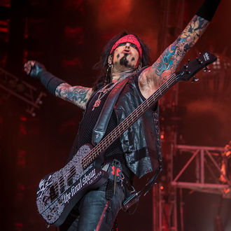 Motley Crüe support band attempt to sue for $30 million after urine prank