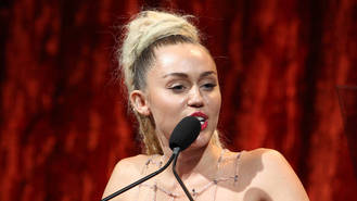 Miley Cyrus supports Dolly Parton's charity push to help fire hit families