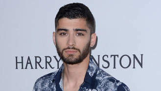 Zayn Malik offers his condolences to Louis Tomlinson following mother's death