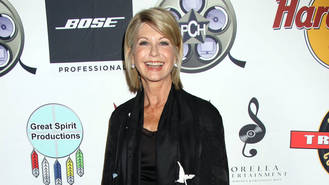 Olivia Newton-John postpones tour after breast cancer diagnosis