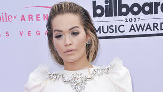 Rita Ora hopes new music will quiet interest in her love life