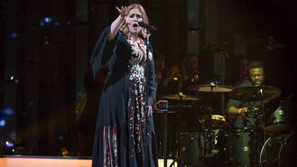 Adele hints at touring retirement in moving hometown concert programme
