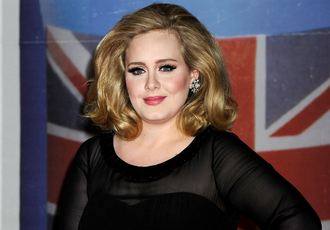 Adele kicks off world tour with live proposal on stage