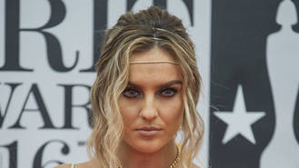 Perrie Edwards in pain after arm burn