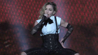 Madonna accidentally exposes fan's breast onstage