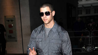 Nick Jonas had bad breath for first kiss with Miley Cyrus