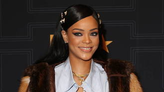 Rihanna bares all for hard-hitting, gun-toting new video