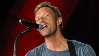 Chris Martin performs surprise set at London homeless shelter