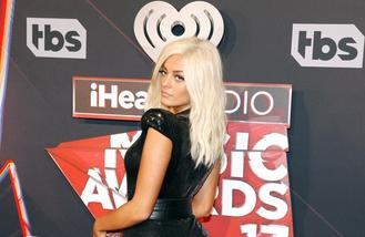 Bebe Rexha takes her brother on tour to stay 'sane'