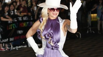 Gaga makes hair-raising arrival
