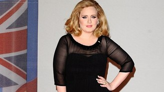 Adele bags apology from Karl